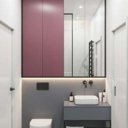Lustro nad umywalką w czarnej ramie; podświetlana szafka z lustrem nad umywalka w łazience; szaro-biała łazienka